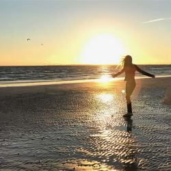 A photo of a Girl on the beach at sunset on Fort Myers Beach.