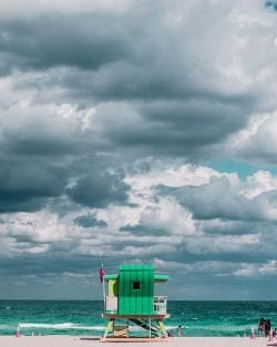 A color photograph of a Beautiful Cloudy day on Miami Beach.