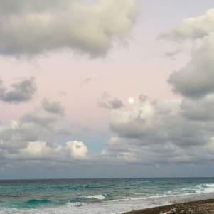Full moon in a purple sky in Great Guana Cay.