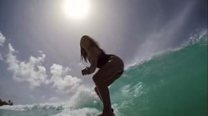 Surfing in Barbados is fun.