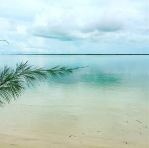 Dreamy photo of the sea, sand and sky only in Binini.