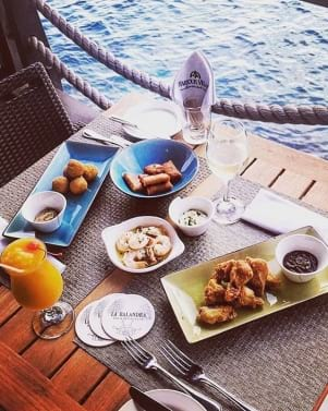 Happy Hour to enjoy the best drinks, bar snacks and view in Bonaire