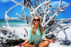 A  girl meditating on Fort Myers Beach