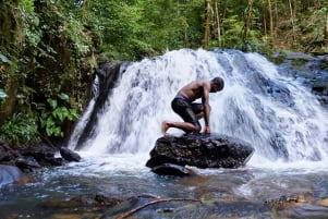 Enjoying the cool waterfalls in Guyane.