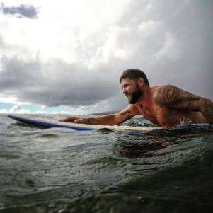 Surfing in the rain in 86 degree H20 in Kauia.