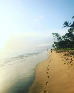 Lovely image of footprints on the sand in Maui