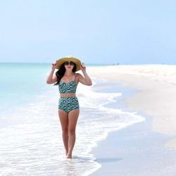 A picture of a A beautiful young woman walking down the beach in Captiva in a vintage bikini!!