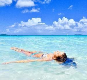 A little mermaid floating by Cinnamon Bay
