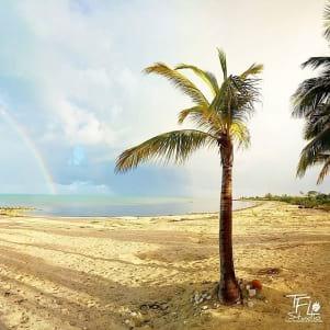 Catching a rainbow around The Acklin Islands of Bahamas