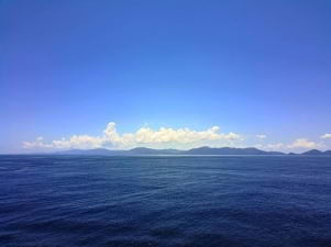The blue sky meets the blue water